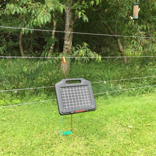 Completed setup of a solar electric fence energiser